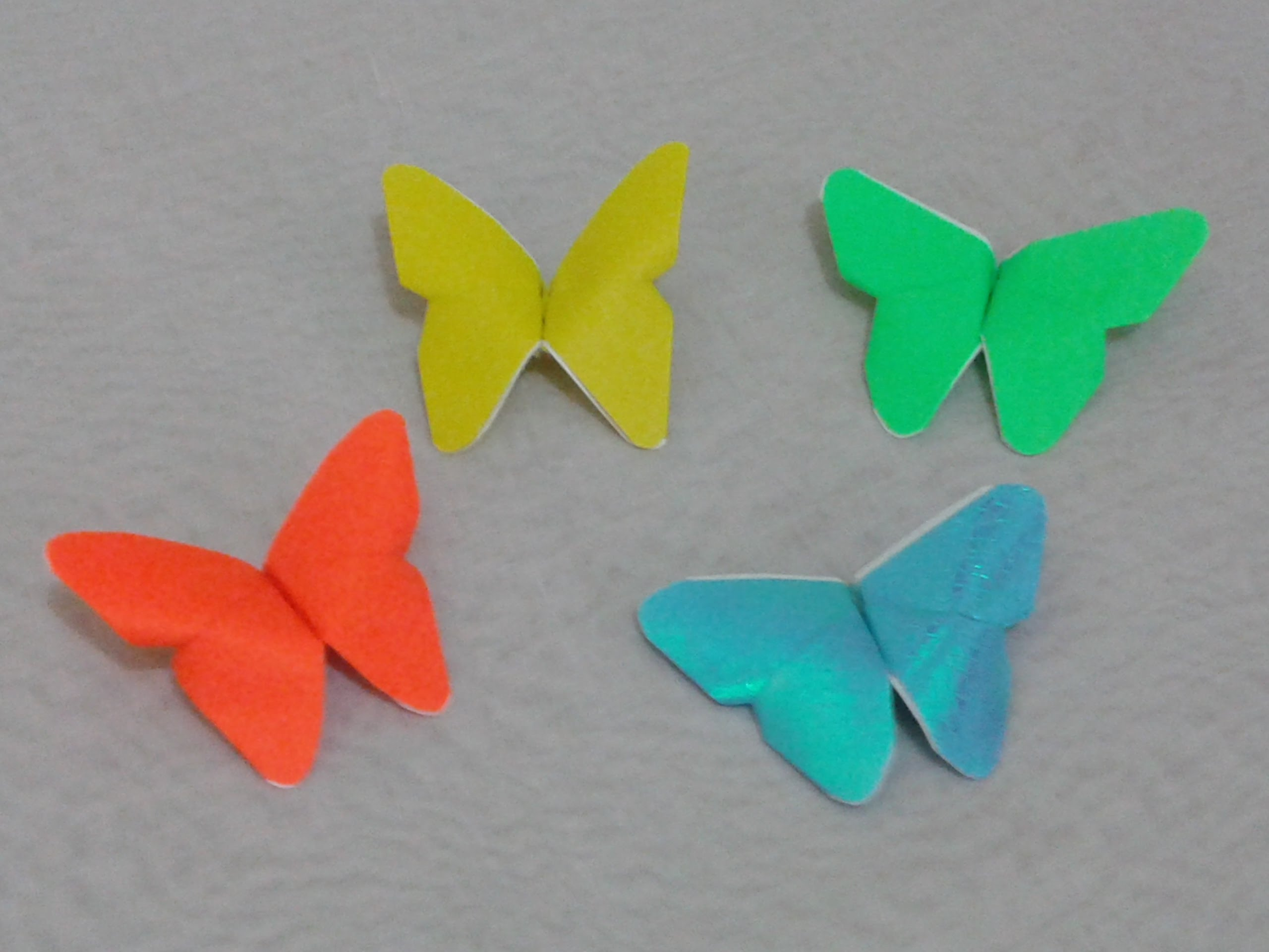 Folded paper origami butterflies