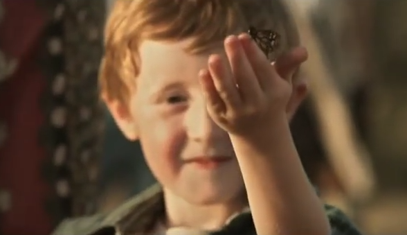 Butterfly circus short film boy holding butterfly